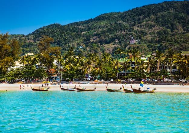 Fishing boats at Patong beachin Phuket, Thailand. Phuket is a popular destination famous for its beaches
