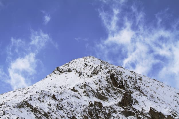Himalayan mountain top and blue sky with clouds in Ladakh, India. Hemis High Altitude National Park
