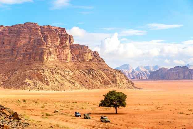 Jordanian desert in Wadi Rum, Jordan viewed from Lawrence's Spring. Wadi Rum is known as The Valley of the Moon and has led to its designation as a UNESCO World Heritage Site