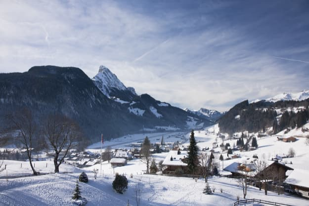 Landscape of Gstaad in Switzerland, with snow in winter