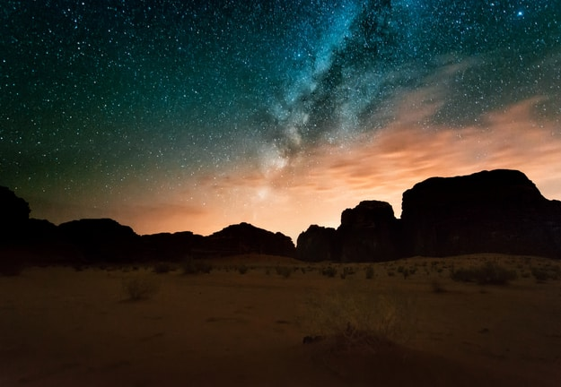 Milky way above red Wadi Rum desert in Jordan