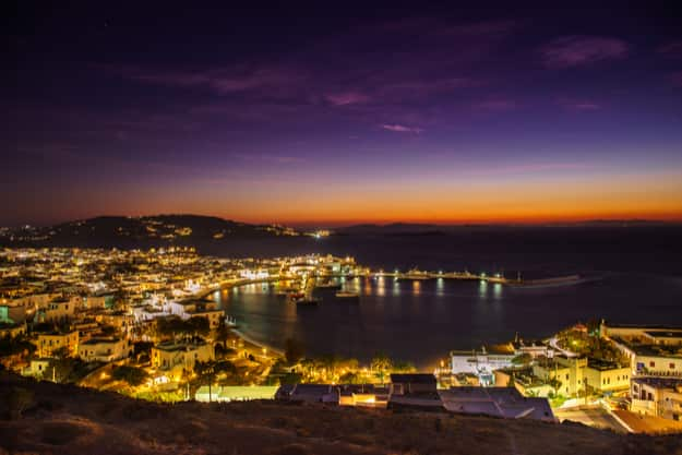 Mykonos island aerial panoramic view at sunset. Mykonos is a island, part of the Cyclades in Greece with old architecture one the foreground