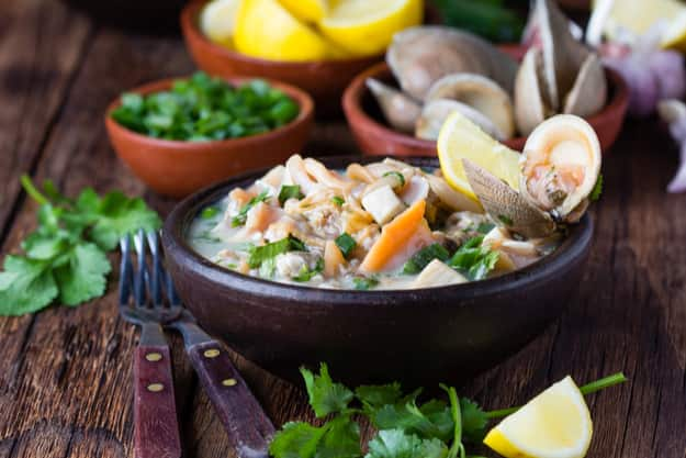 Seafood shellfish ceviche served in a clay bowl, a traditional dish of Peru or Chile