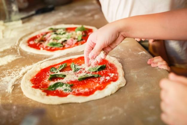 Preparing Pizza Margherita, the archetype of Neapolitan pizza