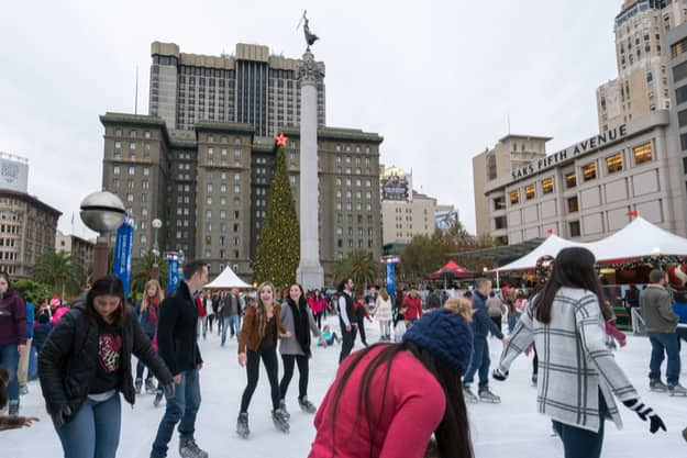 Holiday shoppers enjoy the ice skating rink in Union Square