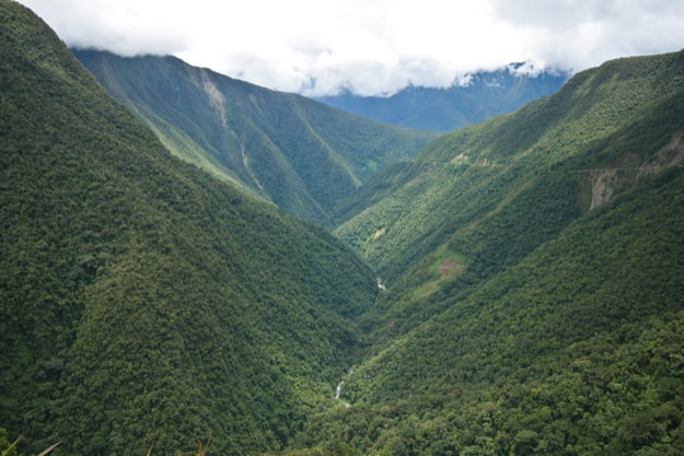 Valley covered in rainforest in the Yungas region of Bolivia, on the eastern slopes of the Andes, leading into Amazon rainforest