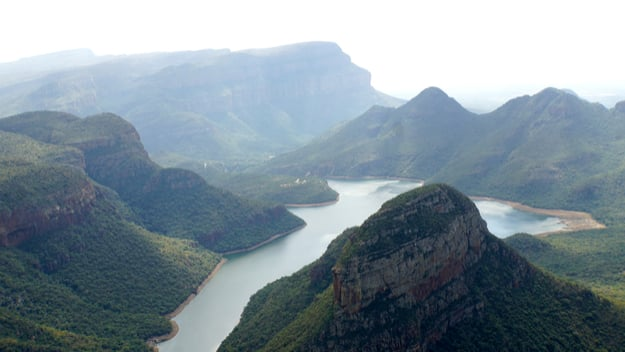 View from Lowveld Viewpoint to the Blyde River Canyon at the panoramic route in South Africa, striking rocks of red sandstone, Mpumalanga provinceNatural wonder at the Panoramic Route