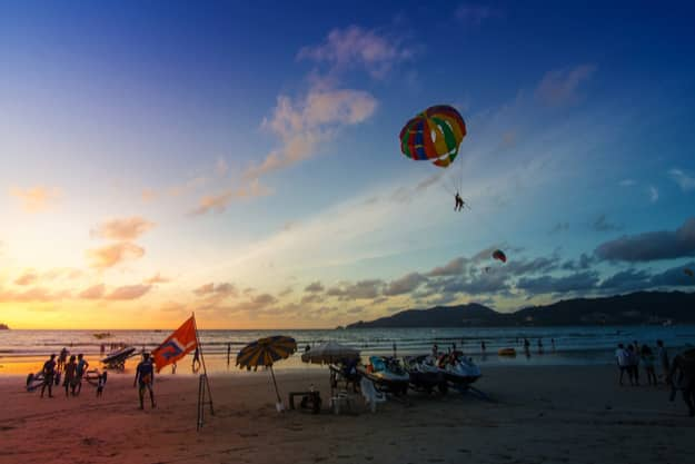 unidentified people are relaxing on Patong beach during a sunny day in Phuket,Thailand.Patong is one of famous beach located in the west coast of Phuket
