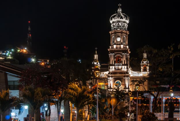 A night shot of the front of the cathedral in Puerto Vallarta