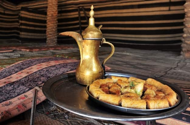 Arabic coffee jug and cookies served in Bedouin tent in the middle east