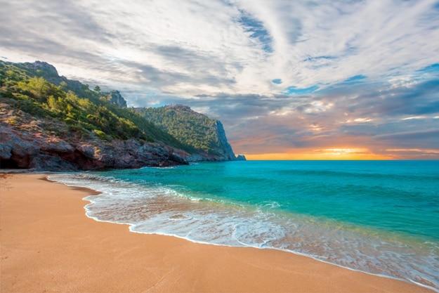 Beach of Cleopatra with sea and rocks of Alanya peninsula, Antalya, Turkey
