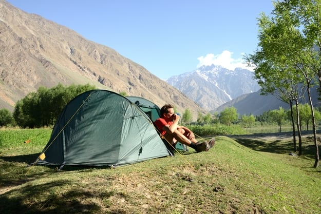 Camping in the Wakhan valley with Afghanistan in the background, Pamir Mountain Range