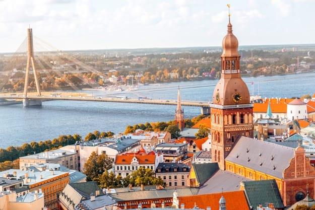 Cityscape aerial view on the old town with Dome cathedral and Daugava river in Riga city