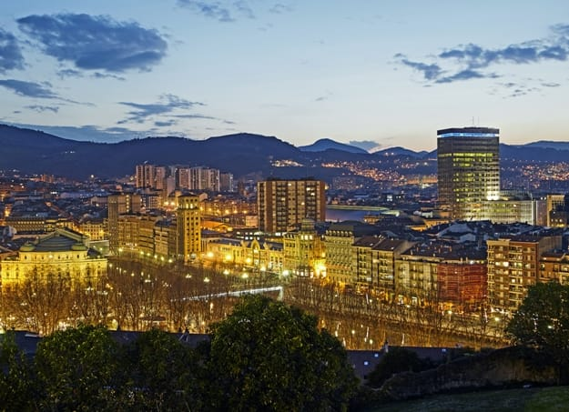 Elevated view of the basque city of Bilbao illuminated at twilight