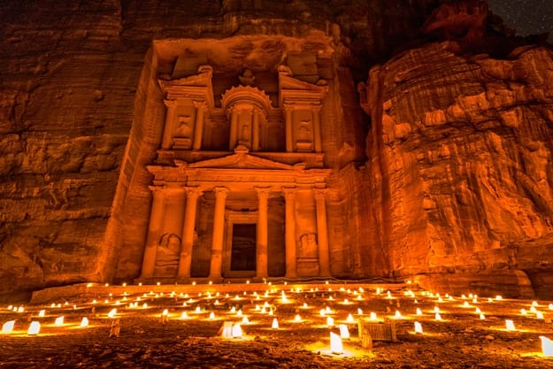 Experience Petra by night by walking the entire Siq to the Treasury to see part of the rock city by candlelight with over 1,500 candles, Petra, Jordan
