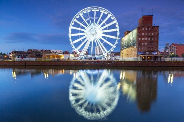Ferris wheel in the city centre of Gdansk at night. Gdansk is the historical capital of Polish Pomerania with medieval old town architecture