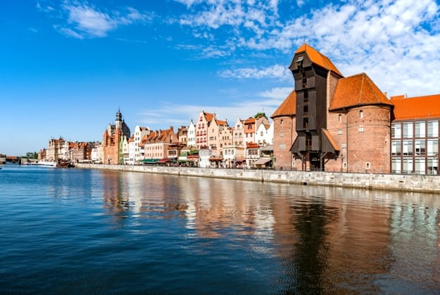 Gdansk old city in Poland with the oldest medieval port crane (Zuraw) in Europe and a promenade along the riverbank of Motlawa River