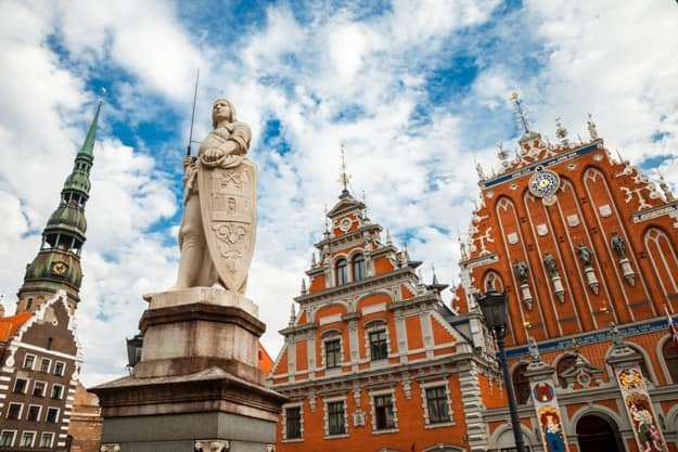 House of the Blackheads, sculpture of Saint Roland and Saint Peters Church in old city Riga, Latvia