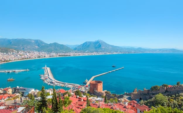 Landscape with marina and Red tower in Alanya peninsula, Antalya district, Turkey