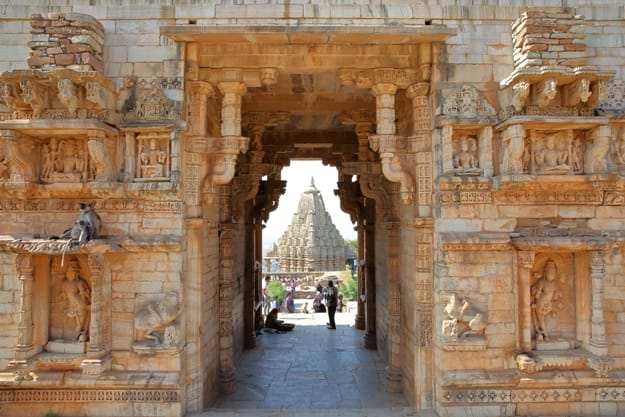Mahasati Gate located inside the fort (Garh) of Chittorgarh, with Samideshwar Hindu Temple in the background