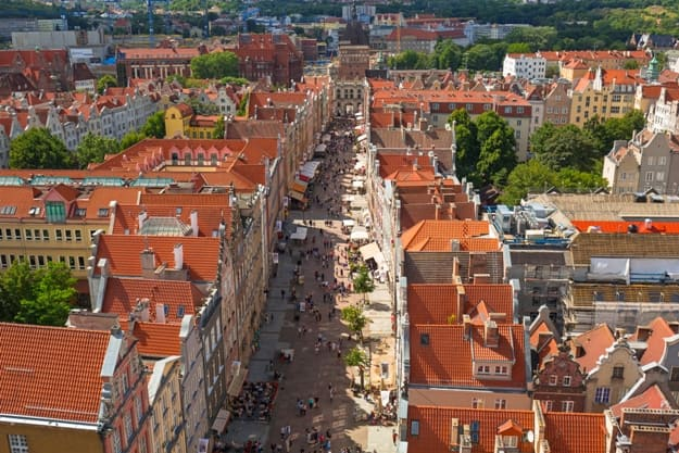 People on the Long Lane of the old town in Gdansk, Poland. Gdansk is the historical capital of Polish Pomerania