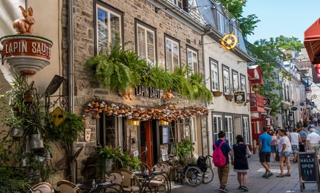 Quebec City, Quebec, Canada - June 2017, pedestrian exploring french charm of old town
