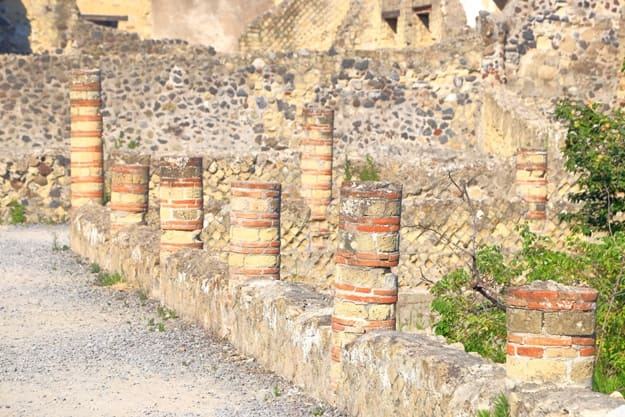 Row of Roman columns from the historical site of Herculaneum near the outskirts of Naples, Italy