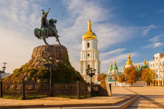 Scenic view on Hetman Bohdan Khmelnitsky monument and Saint Sophia's Cathedral on Sofia Square, Kyiv, Ukraine. Beautiful autumn scenery