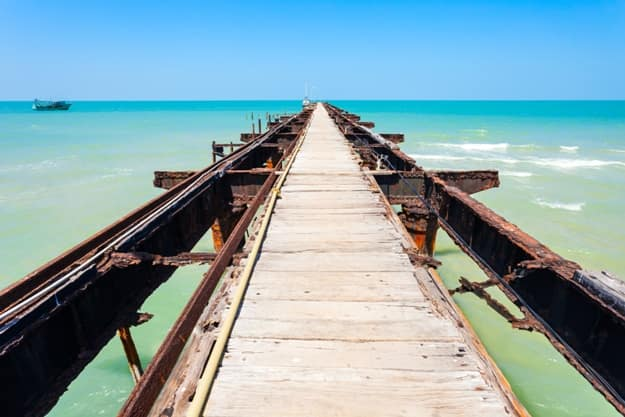 Talaimannar pier, Sri Lanka. Talaimannar is located on the northwestern coast of Mannar Island and about 18 miles from Dhanushkodi indian town