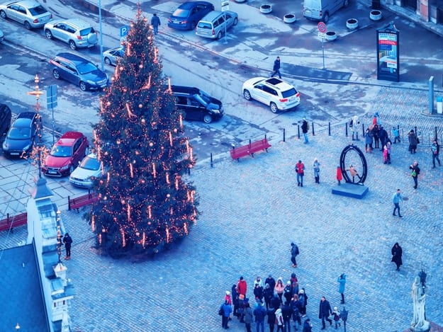 Tourists at Christmas Tree on Town Hall Square in Riga Old Town, in winter