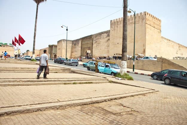 Traffic among old city fortification walls on July 28, 2010 in Meknes, Morocco. Meknes is one of the oldest imperial city in Morocco