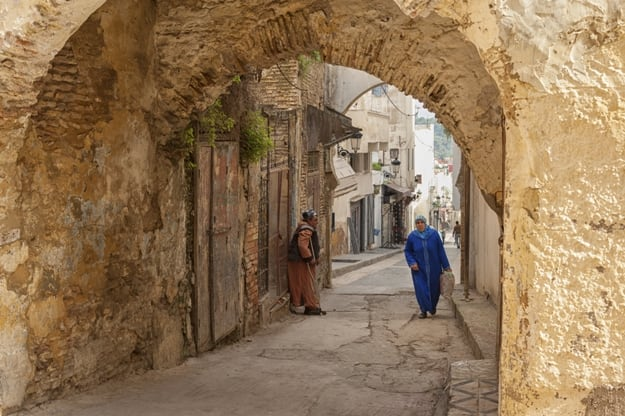 Unidentified people walking in the street of Meknes, Morocco. Meknes is one of the four Imperial cities of Morocco
