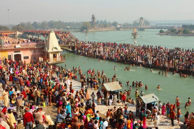 Puja ceremony on the banks of Ganga, people celebrate Makar Sankranti