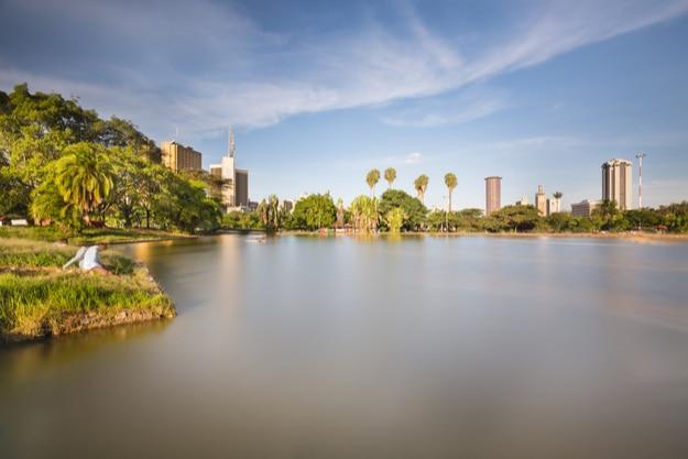 Skyline of Nairobi, Kenya with the beautiful lake in Uhuru Park in the foreground