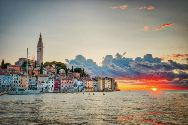 Old town of Rovinj during sunset with a colorful sky and the Adriatic Sea