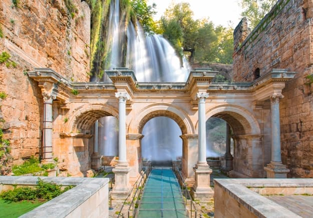 View of Hadrian's Gate in old city of Antalya with duden waterfall - Turkey