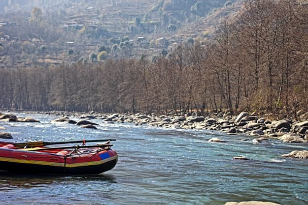 Anchored white water rafting boat in the Himalayas at the Beas river in Manali, India