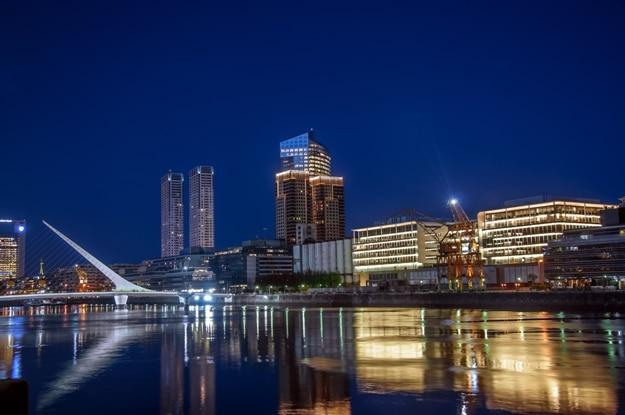 Beautiful Puerto Madero and the Women's Bridge at night