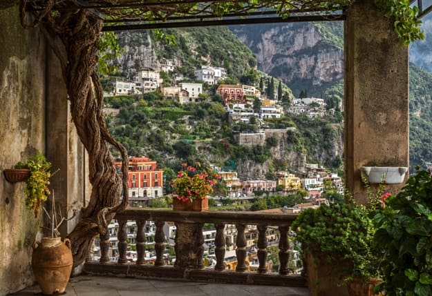 Idyllic view of the historic and famous coast village Positano with its church near Naples in South Italy