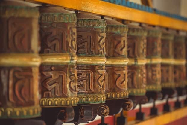 Tibetan metal prayer wheels with mantras at Manali