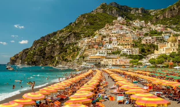 Tourists relaxing on a beach in Positano, Italy