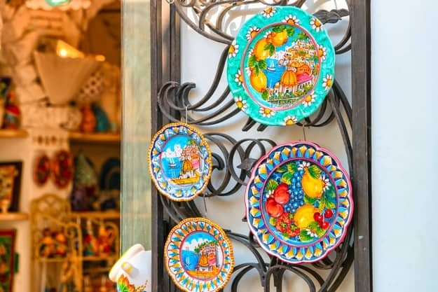 Traditional colorful ceramics plates made of clay on display in Positano town, Amalfi coast, Italy