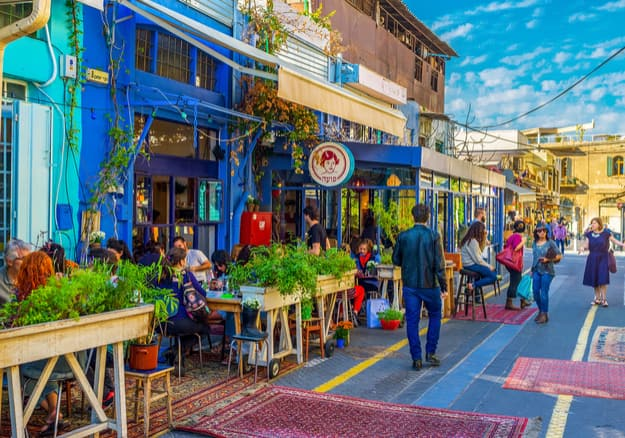 The flea market neighborhood of old Jaffa is full of the cozy cafes, decorated with plants in pots, colorful rugs and wooden details