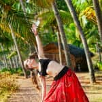 Female practising yoga - Kerala