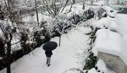 Srinagar receives first snowfall of the season ending dry spell. VIEW PICS.