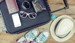 What's the one travel essential that you absolutely can't do without? VOTE