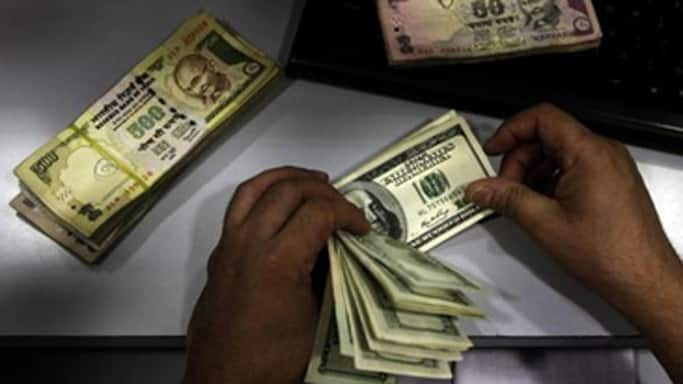 Rupee down by 13 paise against USD