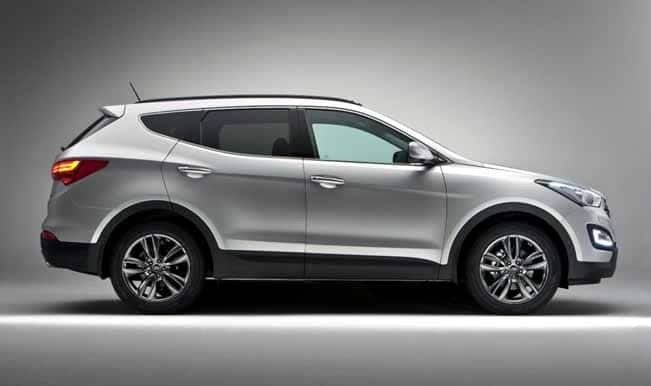 new car launches by hyundaiAuto Expo 2014 Hyundai launches new Santa Fe unveils Xcent sedan
