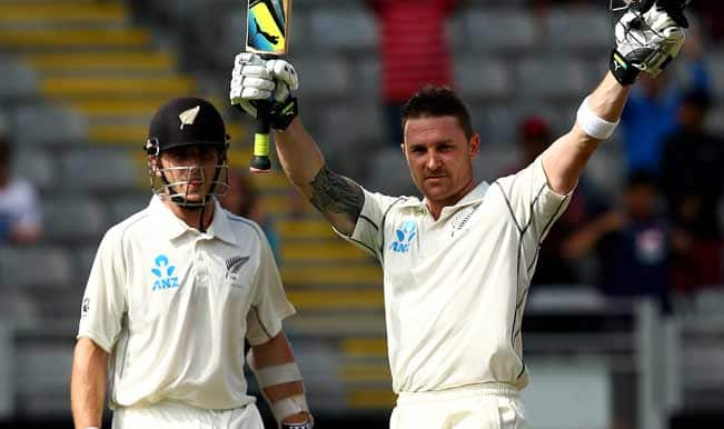 Brendon-McCullum-of-New-Zealand-celebrates-his-century-as-Kane-Williamson-looks-o