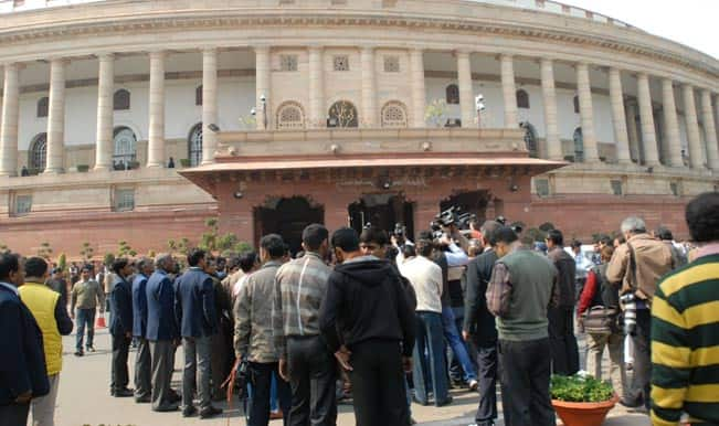 Telangana bill causes stir in Parliament, 17 Lok Sabha MPs suspended